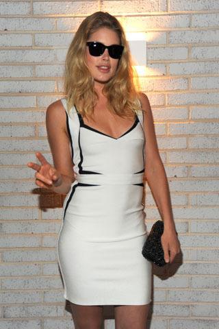 Supermodel Doutzen Kroes white black trim Estelle Herve Leger dress