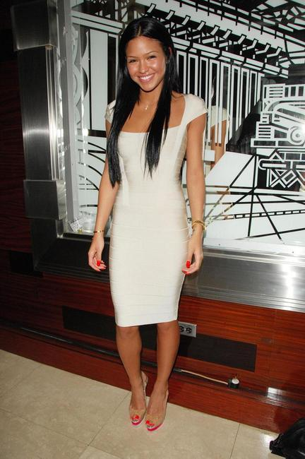 Cassie in white cap sleeve herve Leger dress